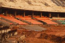 Seats being afixed on lower tier (Close up of hectic activity on South Side (13-Dec-2014)